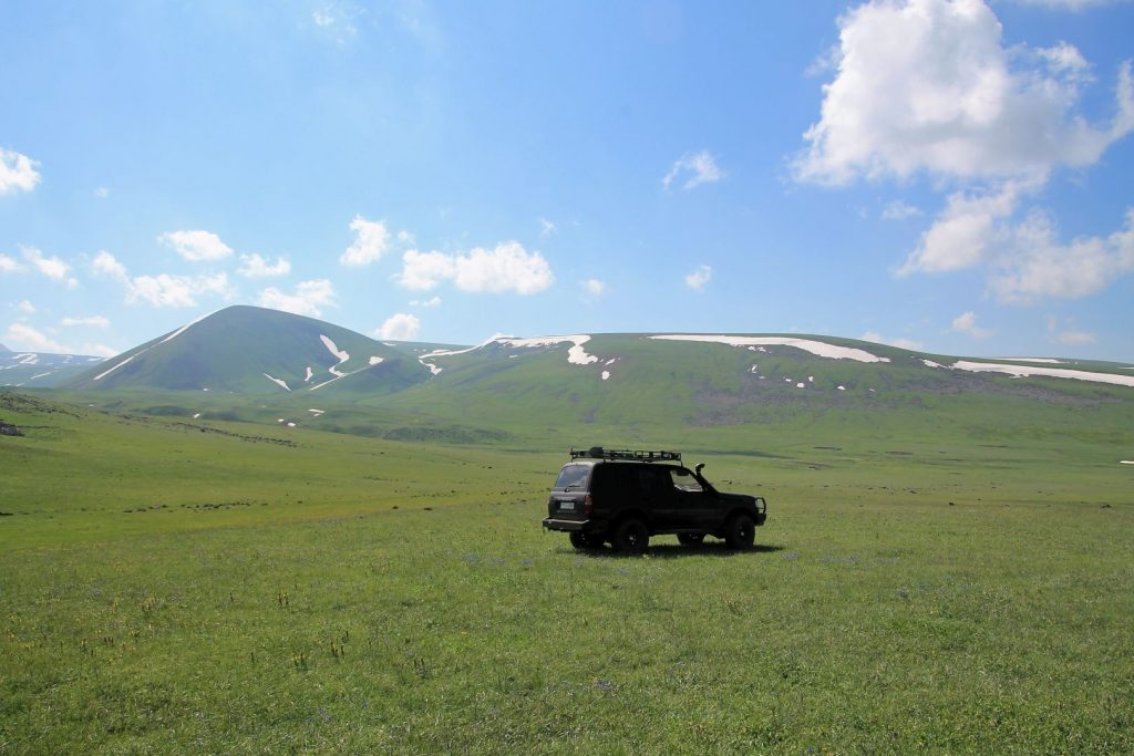 Parking the car on a flowery meadow and start hiking from here