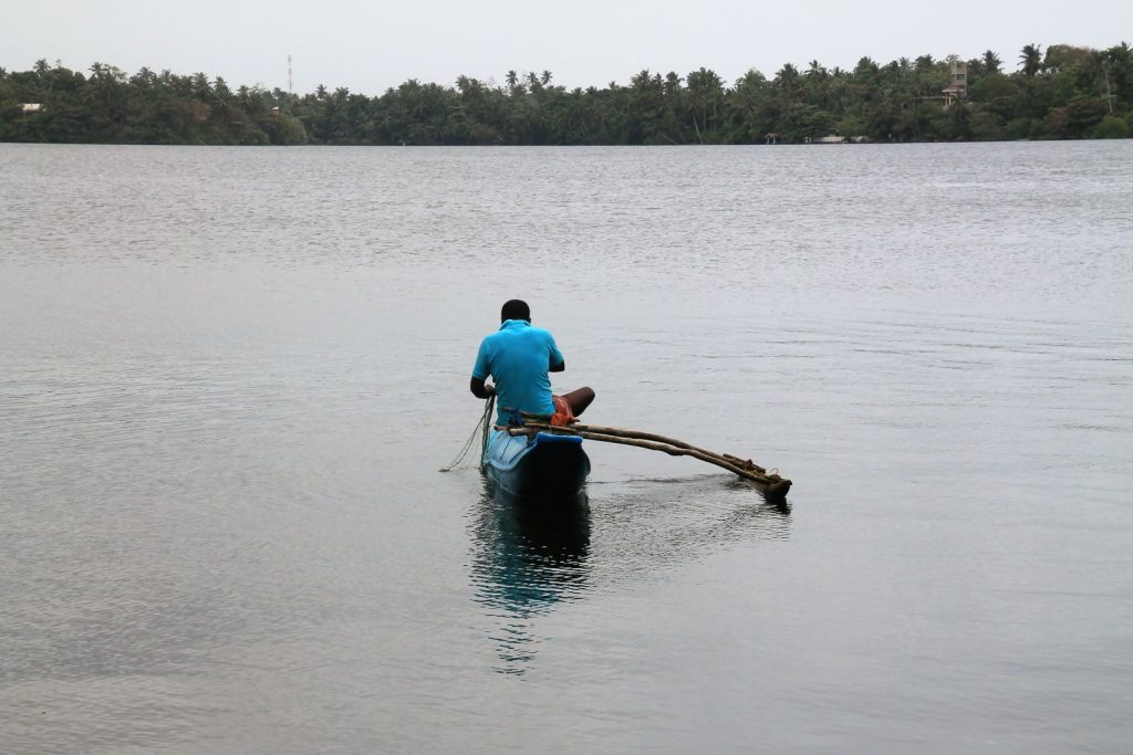 Fisherman working at the lagoon