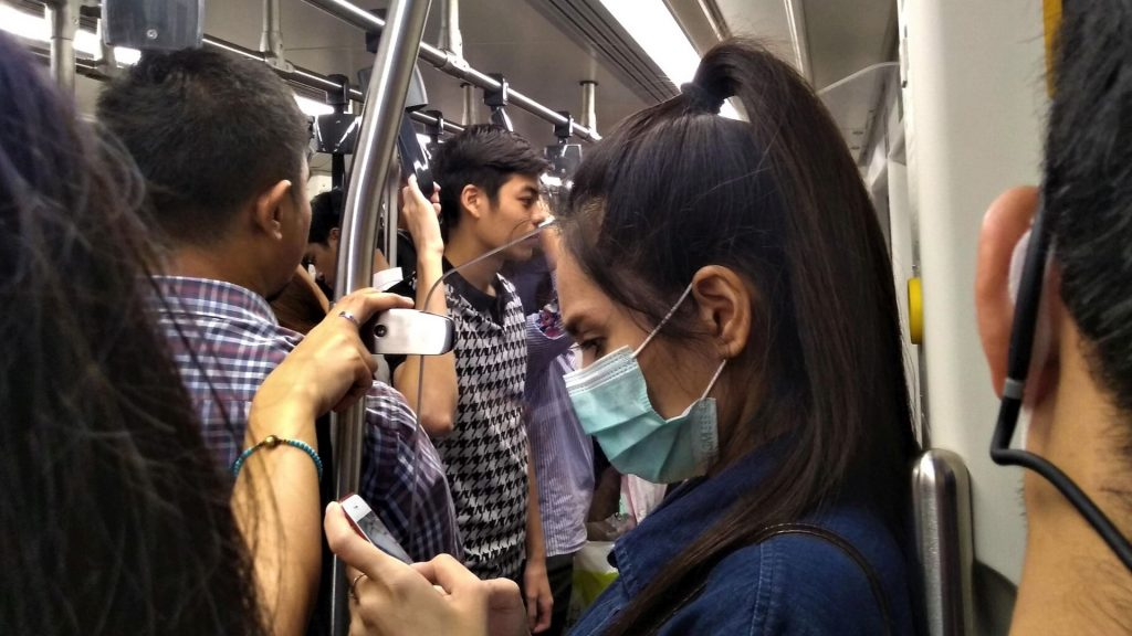 Woman wearing a mask in the skytrain